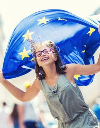 Young girl holding an EU flag