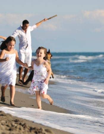 An expat family enjoying the beach