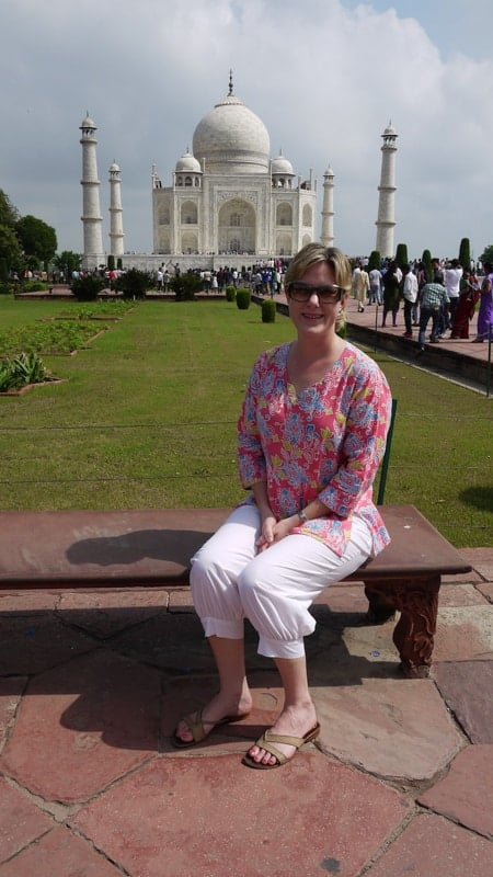 Expat Emily sitting in front of the Taj Mahal