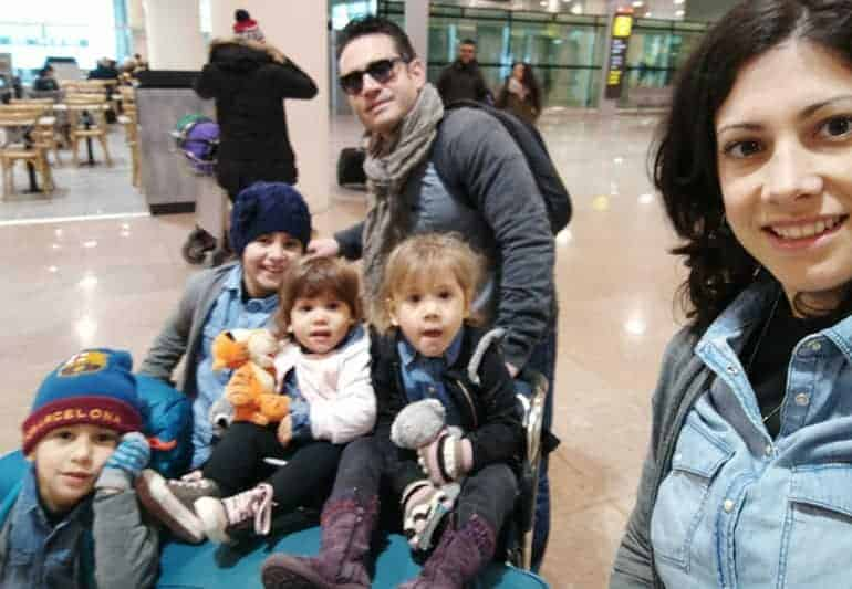 At the airport with her family