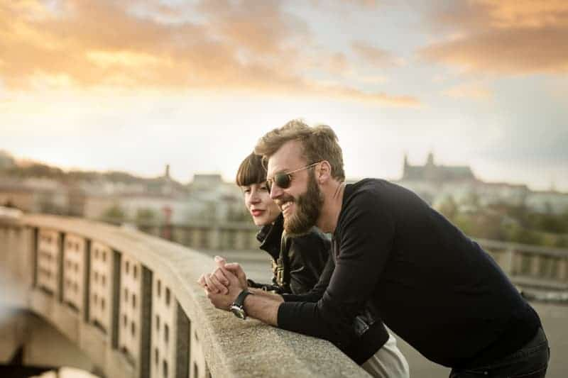 Two young freelancers and digital nomads on a bridge in Prague