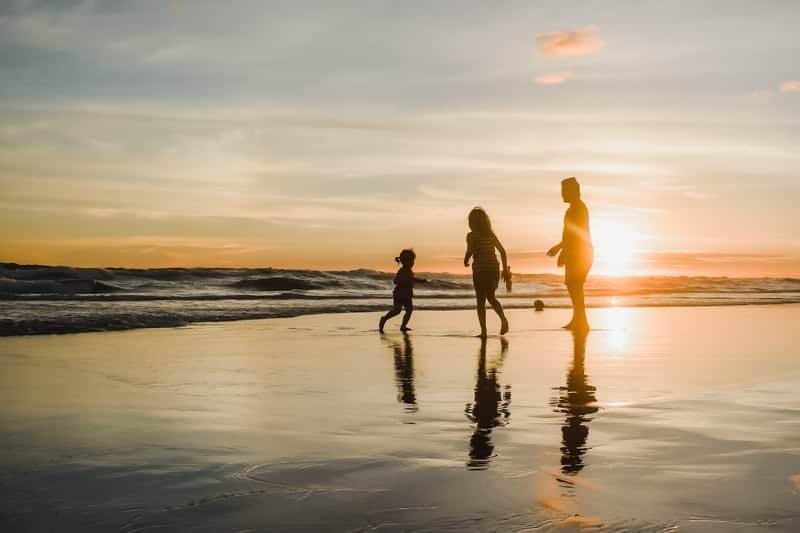 An expat family enjoying themselves on the beach