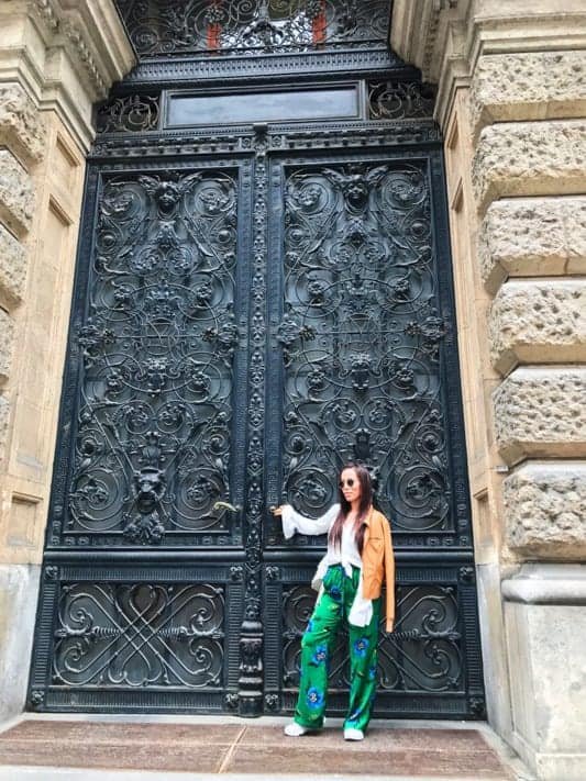 Expat Sable outside a beautiful door in Budapest