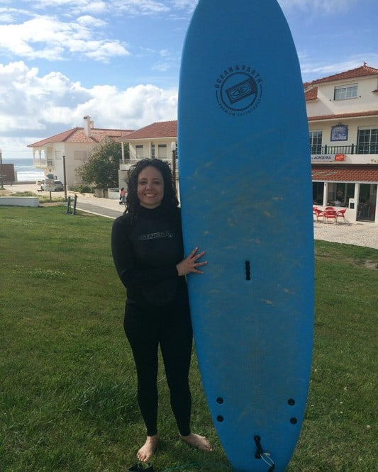 Camilla surfing in Portugal
