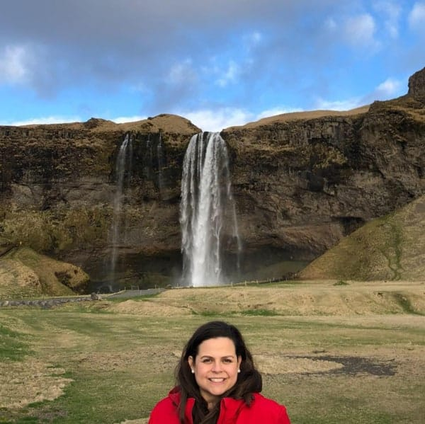 Flor Garcia at a waterfall telling her Expat Story