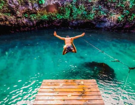 Man jumping into water in American Samoa