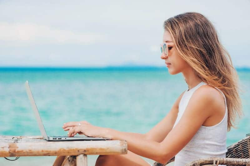 Digital Nomad on the beach after getting her freelancer visa