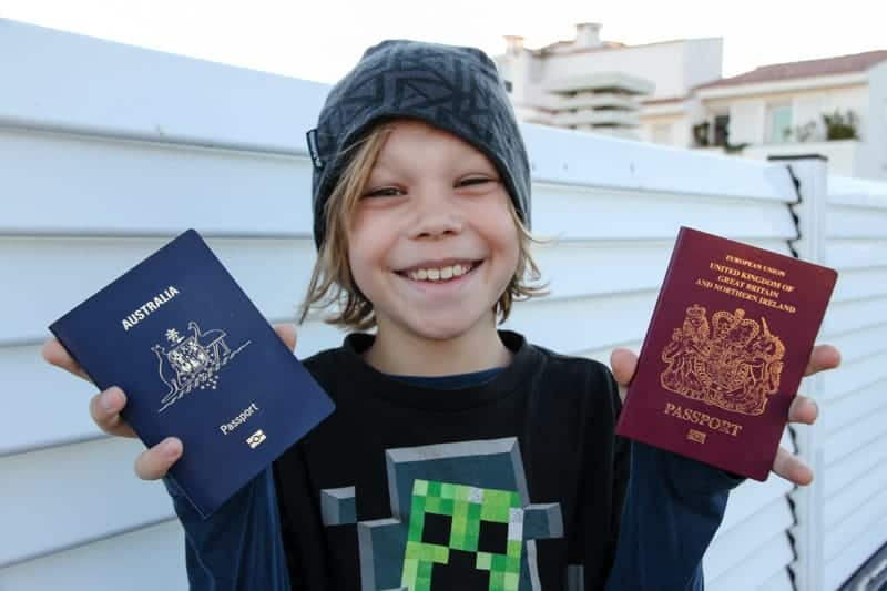 My son smiling with his second passport