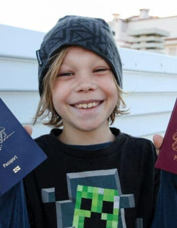 My son holding his two passports