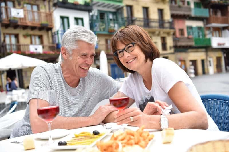Couple enjoying the healthy food in Spain.