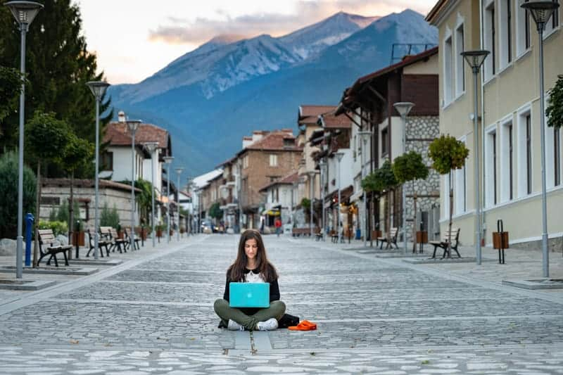 A digital nomad working on her laptop in costa rics