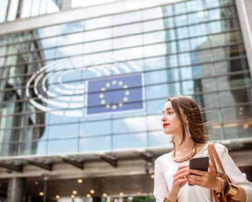 Woman in Brussels under an EU flag