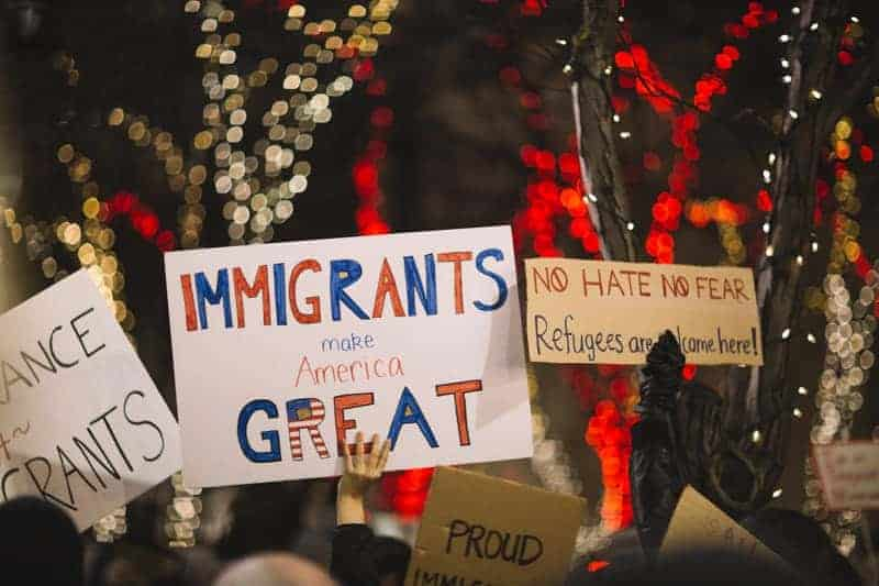 A sign saying immigrants make America great