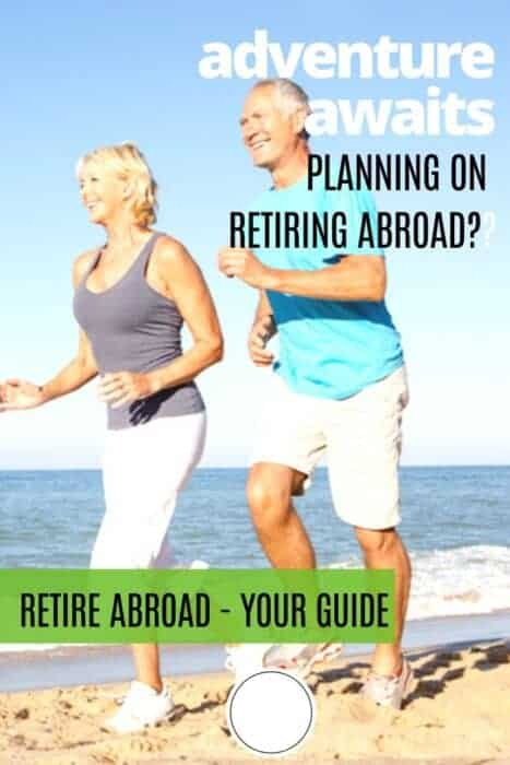 Retired couple on the beach and words Retire abroad your guide