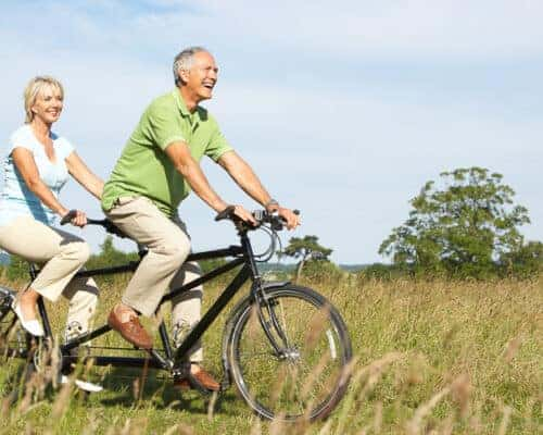 Healthy couple on bicycles