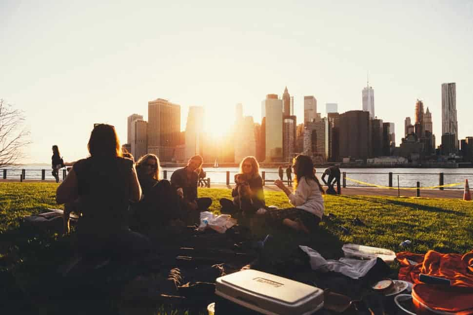International students hanging out in Brooklyn Bridge Park, New York.