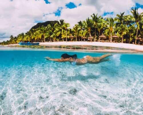 Young woman swiming in Mauritius where you want citizenship