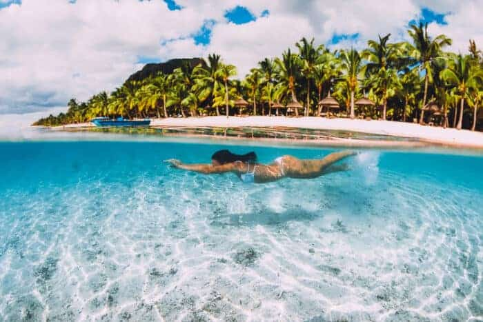 Girl Swimming in Mauritius, a great place to get citizenship.