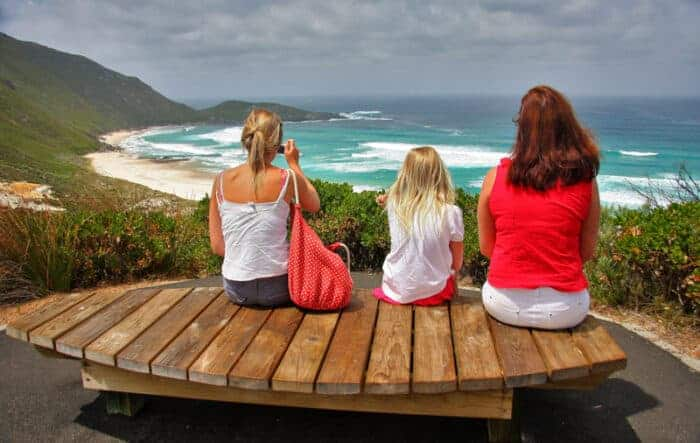 Family looking over the beach in Australia, one of the safest countries in the world