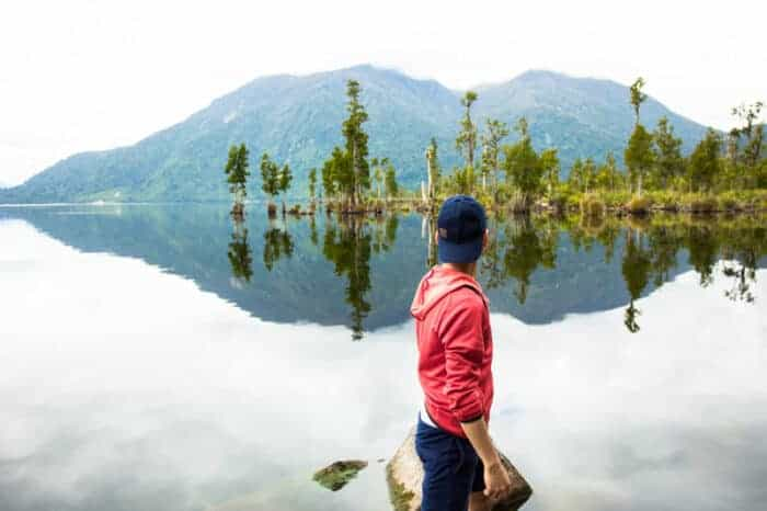 A man at a lake in the safe country of New Zealand