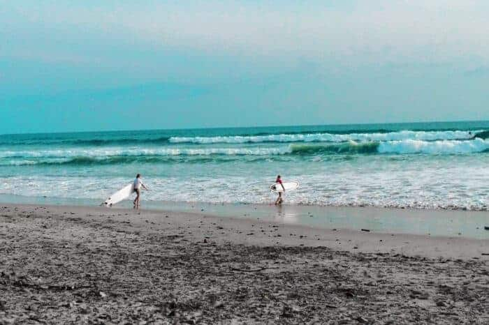 Surfers on the beach in Costa Rica.  One of the safest countries in the world