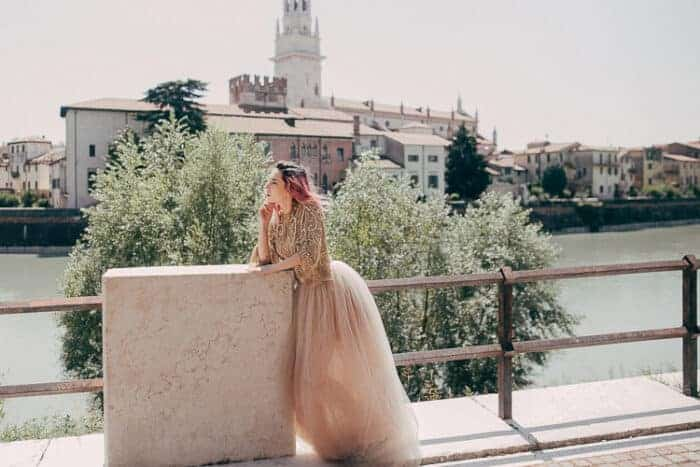 A girl next to a river in Italy