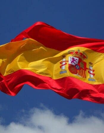 A Spanish flag, symbol of Spanish citizenship and passport.