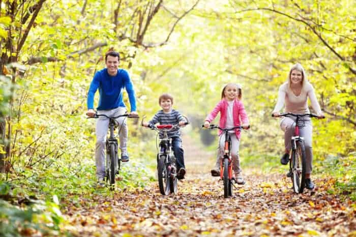 A family on bicycles enjoying life in Europe
