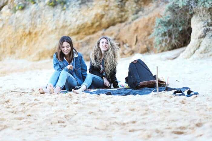 Girls on the beach in the Algarve in Portugal.