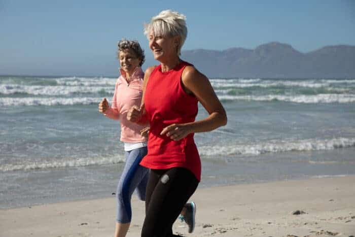 Healthy US citizens running on the beach