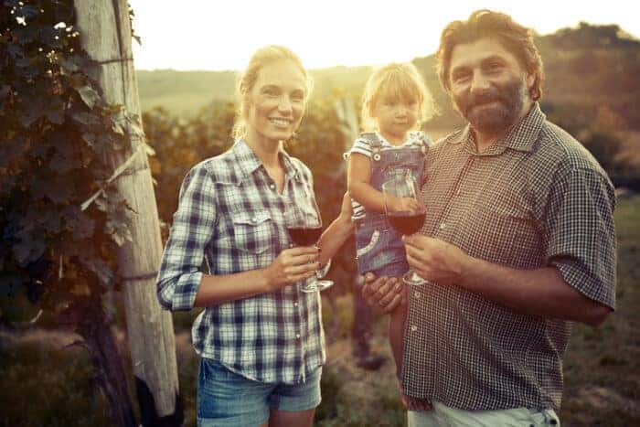 A family that has moved to Italy in a vineyard