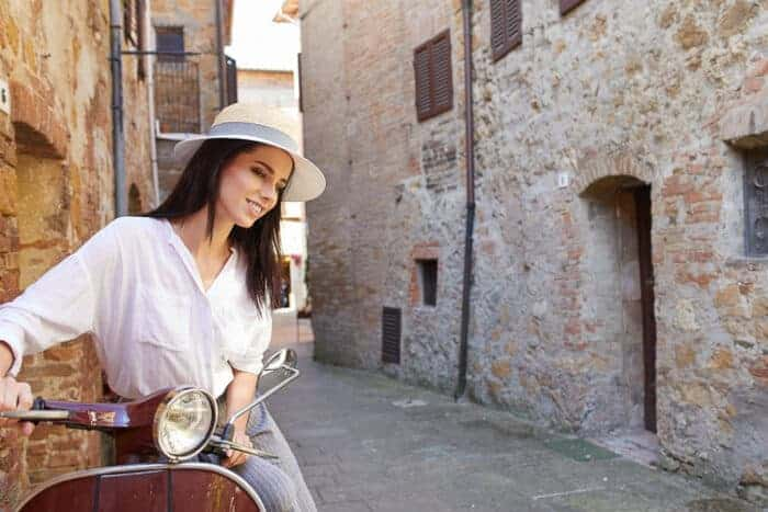 A woman on a scooter in Italy