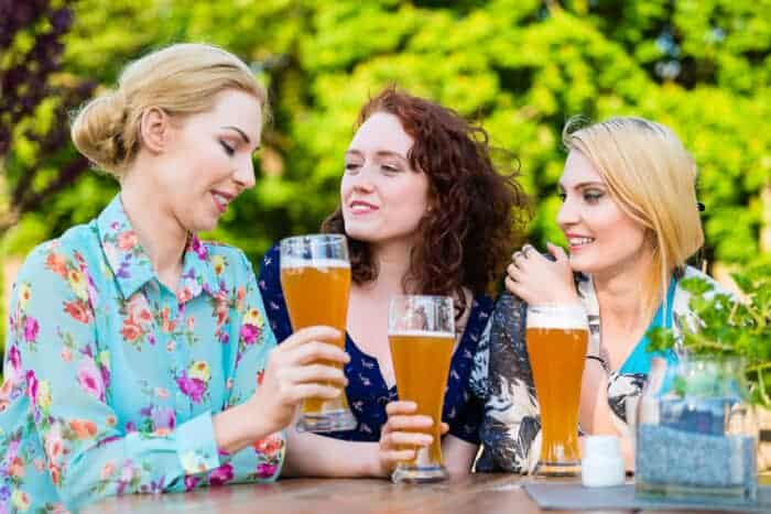 Friends in a beer garden in Germany who have their Germany visas