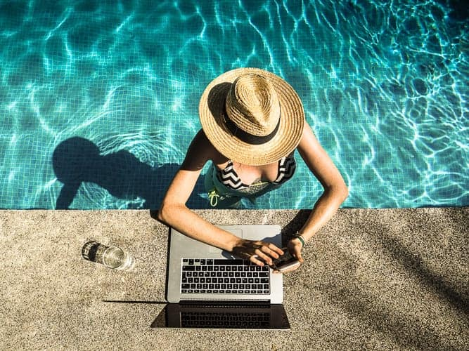 A woman in a pool transferring money abroad