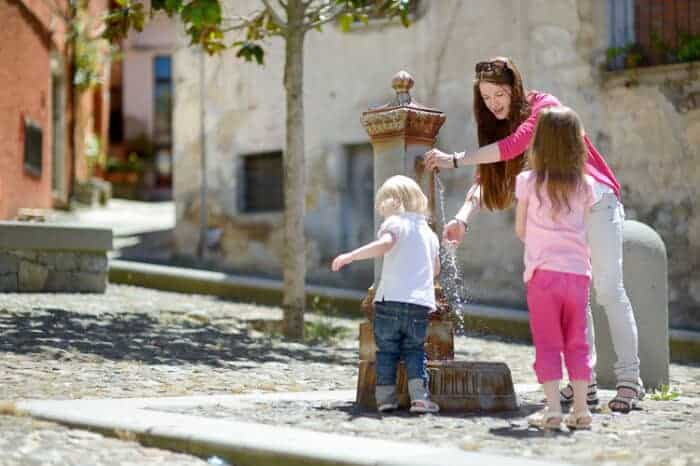 A family at the water fountains in Italy