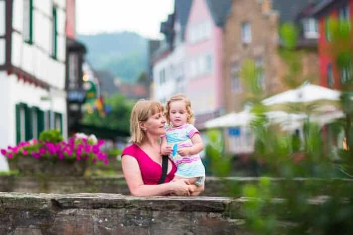 Woman and her daughter on a bridget in Germany