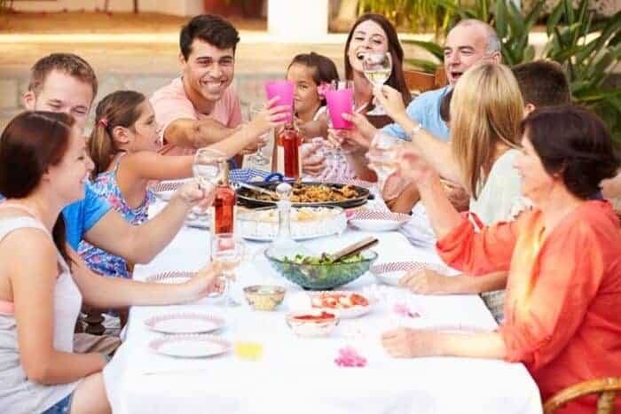A family enjoying a lunch together enjoying living in Spain on a Golden Visa.