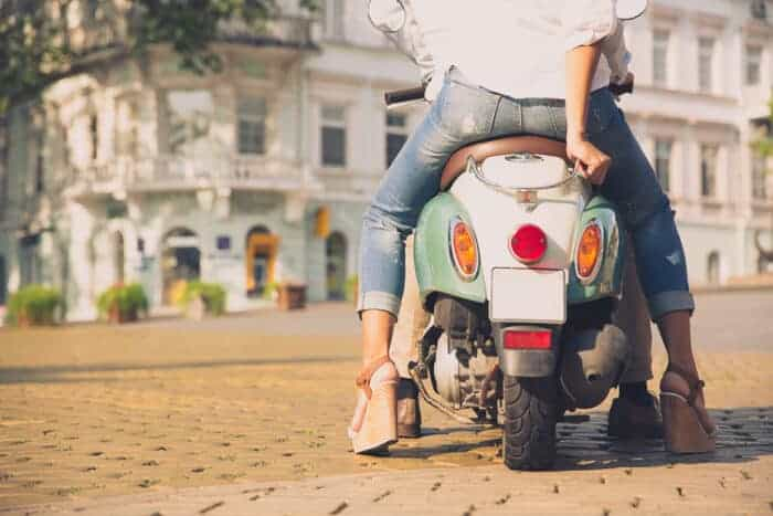 A girl on a scooter living in Italy