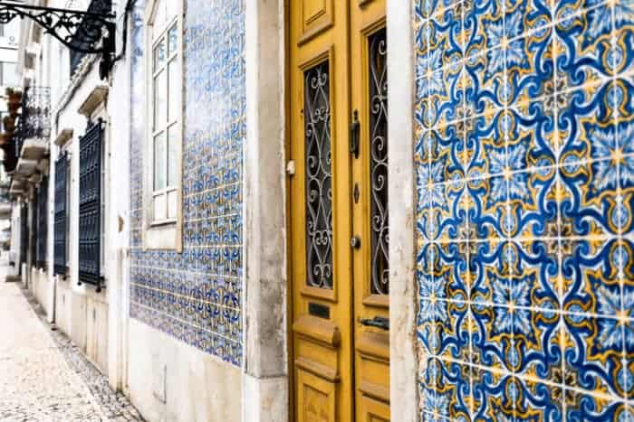 The side of a house in Portugal showing pretty tiles