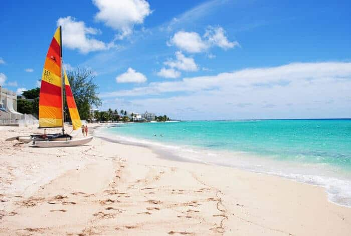 A sail boat on the beach in Barbados
