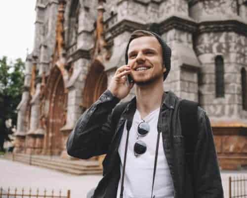 A cheerful man on the phone moving to Ireland