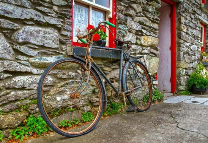 A Bicycle leaning against an old building in Ireland