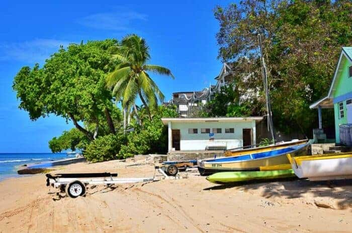 A boat on a beach in Barbados.  An activity that citizens enjoy.