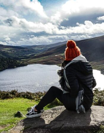 A girl overlooking a lake in Ireland