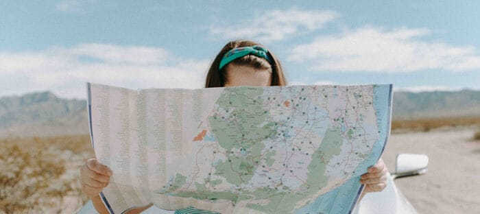 A girl looking at a map starting her new life abroad