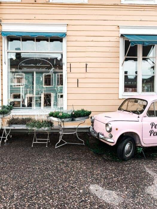 A cute building and old car in Estonia