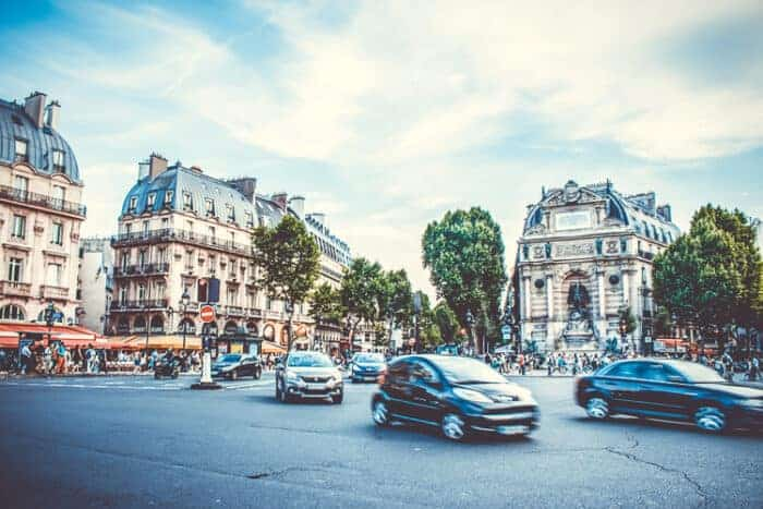 A scene of cars in a French road