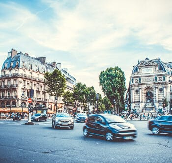 A street scene of cars moving in France